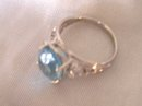 A Ladys-6.00cts Blue Topaz/.03ct diamond/ 4.90 grams 14K White gold