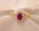 Ladys Ring: .75 cts.Ruby and .33cts. Diamonds:,4.40 grms.Yellow  gold