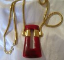 A Trifari Red Bakelite Necklace On Gold Chain