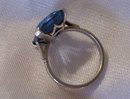A  Ladys Large Dark Blue Topaz Ring in 14K White Gold-5.0 grams.