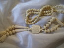 Antique Vintage carried rose and ivory bead necklace, 49.2 grams