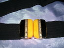 A  Vintage Bakelite black and yellow Belt buckle on Black cloth ladys belt