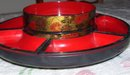 An Asian vintage plastic Lazy Susan Red and Black Decrative arts rotating tray with 6 compartments