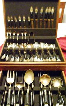 A vintage complete 59 piece set Ebony carved wood- Hand hammered, ebony handle silverware