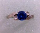 A ladys 1 carat London Blue Topaz Ring with two  white topaz