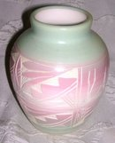 A  Horizonal pottery vase, Hand painted by Native American Artist