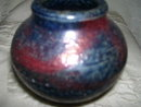 A- Karen Karnes ?-New York 20th century- Blue and red salt fired pottery vase
