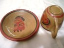 A Signed Nicaragua pottery cup and saucer
