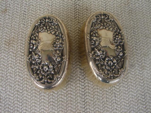 C. 1920 PAIR STERLING REPOUSE BRUSHES