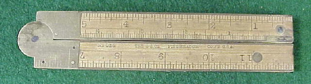 folding brass and wood ruler with level and