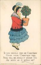 Tuck's Christmas postcard, woman holding potted plant