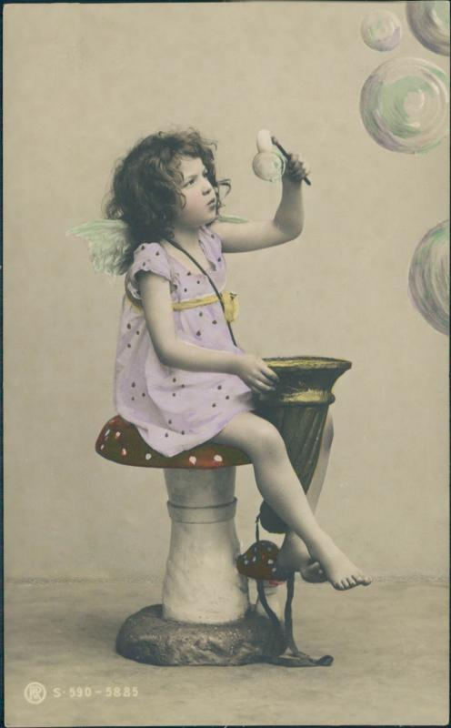 Vintage postcard, tinted photo of a little girl with bubbles