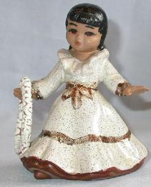 Hawaiiana girl figurine with a lei