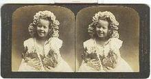 STEREOVIIEW -GIRL IN EASTER BONNET HOLDING TWO BUNNIES