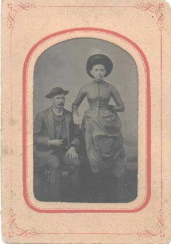 TINTYPE OF VICTORIAN COUPLE WITH GREAT HATS