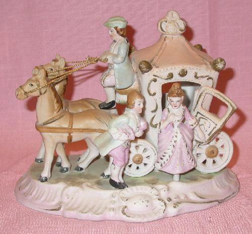 FIGURINE:  JAPAN MARKED CINDERELLA COACH, COACHMAN, MAN AND LADY WITH TWO HORSES FIGURINE