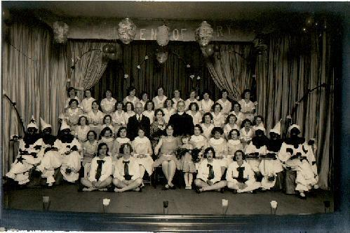 PHOTOGRAPH OF STAGE SHOW WITH BLACK FACE PERFORMERS