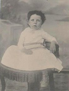 TINTYPE OF CUTE LITTLE GIRL SITTING IN CHAIR