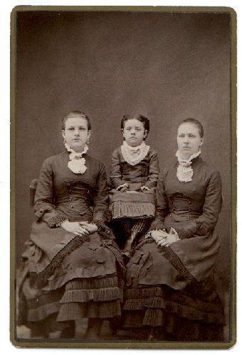 CABINET PHOTO OF THREE GIRLS IN VICTORIAN DRESS