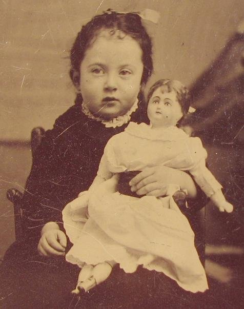 A GIRL & HER DOLL - 1870s TINTYPE PHOTOGRAPH