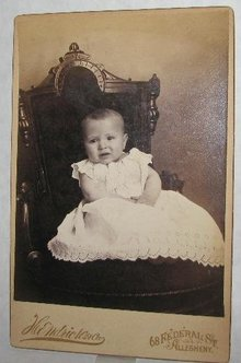 UNHAPPY BABY IN GREAT VICTORIAN CHAIR