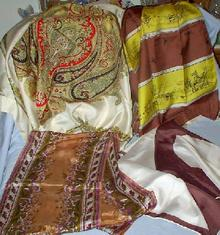 A GROUP OF FOUR VINTAGE SCARVES