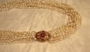 Glamorous 10 Strand Pearl Necklace with Pendant of Pink Sapphires and Diamonds Set in 18 Karat Gold