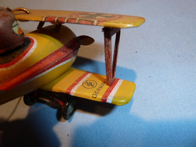 VINTAGE GERMAN ZZ TIN LITHO WWII BIPLANE AND PILOT ORNAMENT