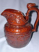 BROWN POTTERY HORSE RACE PITCHER