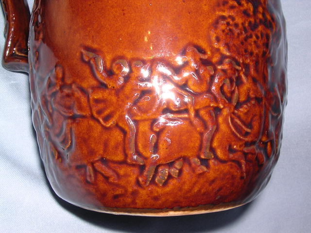BROWN POTTERY HORSE RACE PITCHER ROCKINGHAM STYLE