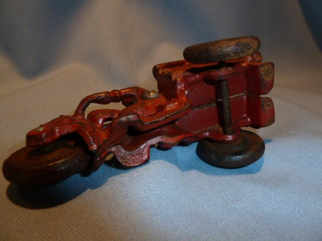 ANTIQUE CAST IRON RED CRASH CAR HARLEY WITH DRIVER AND CRASH CART