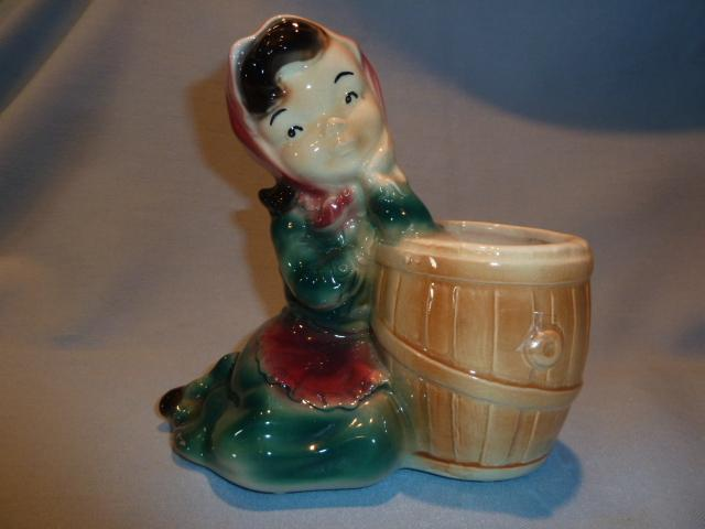 VINTAGE ROYAL COPLEY GIRL LEANING ON A BARREL PLANTER