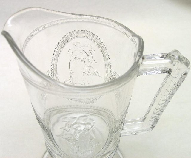 EAPG Cupid and Venus Footed Milk Pitcher