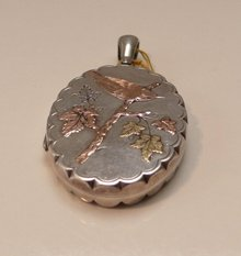 Victorian Sterling Silver Locket with gold overlay
