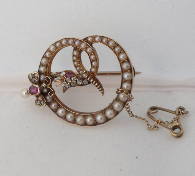 Victorian 18 Kt. Gold and Pearls and ruby Serpent Brooch
