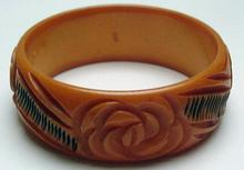 Bakelite Butterscotch and Black Carved Flower Bangle