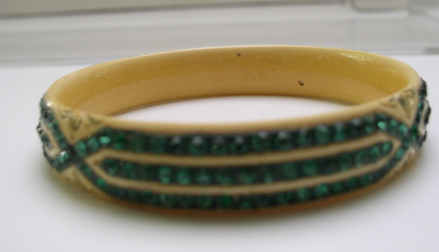 Celluloid cream colored bangle with green