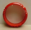 Bakelite Coral Red Carved Bangle