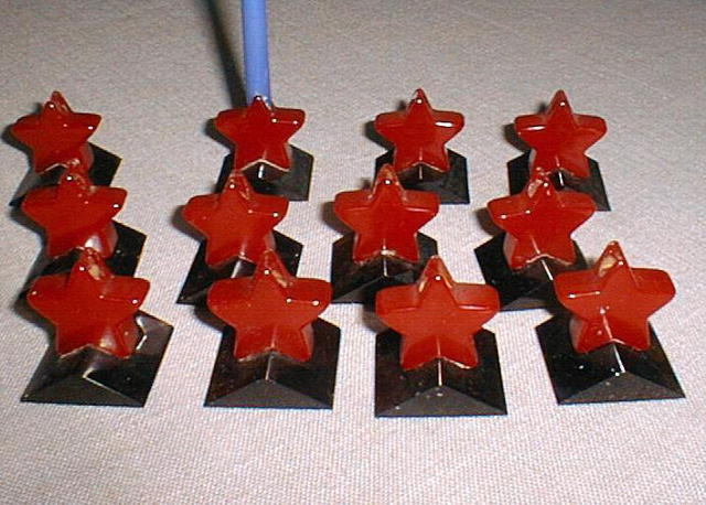 Bakelite set of 12 star candlestick holders