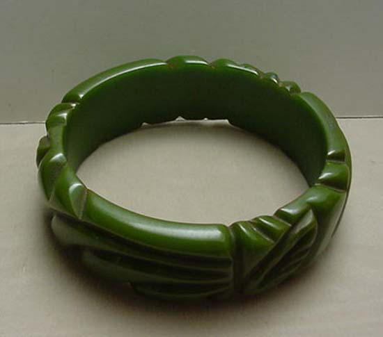 Bakelite green carved bangle