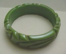 Bakelite green carved bangle
