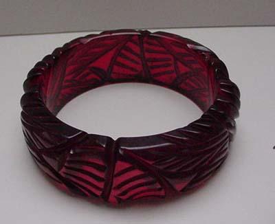 Bakelite Carved Red Translucent Bangle