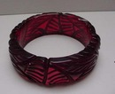 Bakelite Carved Red Translucent Bangle