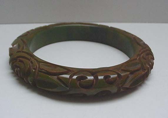Bakelite Marbelized Green Deeply carved flowers