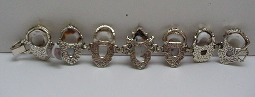 Costume jewelry Bracelet with Asian faces