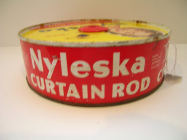 Nyleska Expanding Curtain Rod Advertising Tin