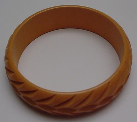 Bakelite butterscotch carved bangle