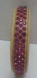 Celluloid bangle with pink rhinestones