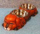 Dog with a set of (2) dishes