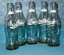 Coke Bottles (4) light green colored glass